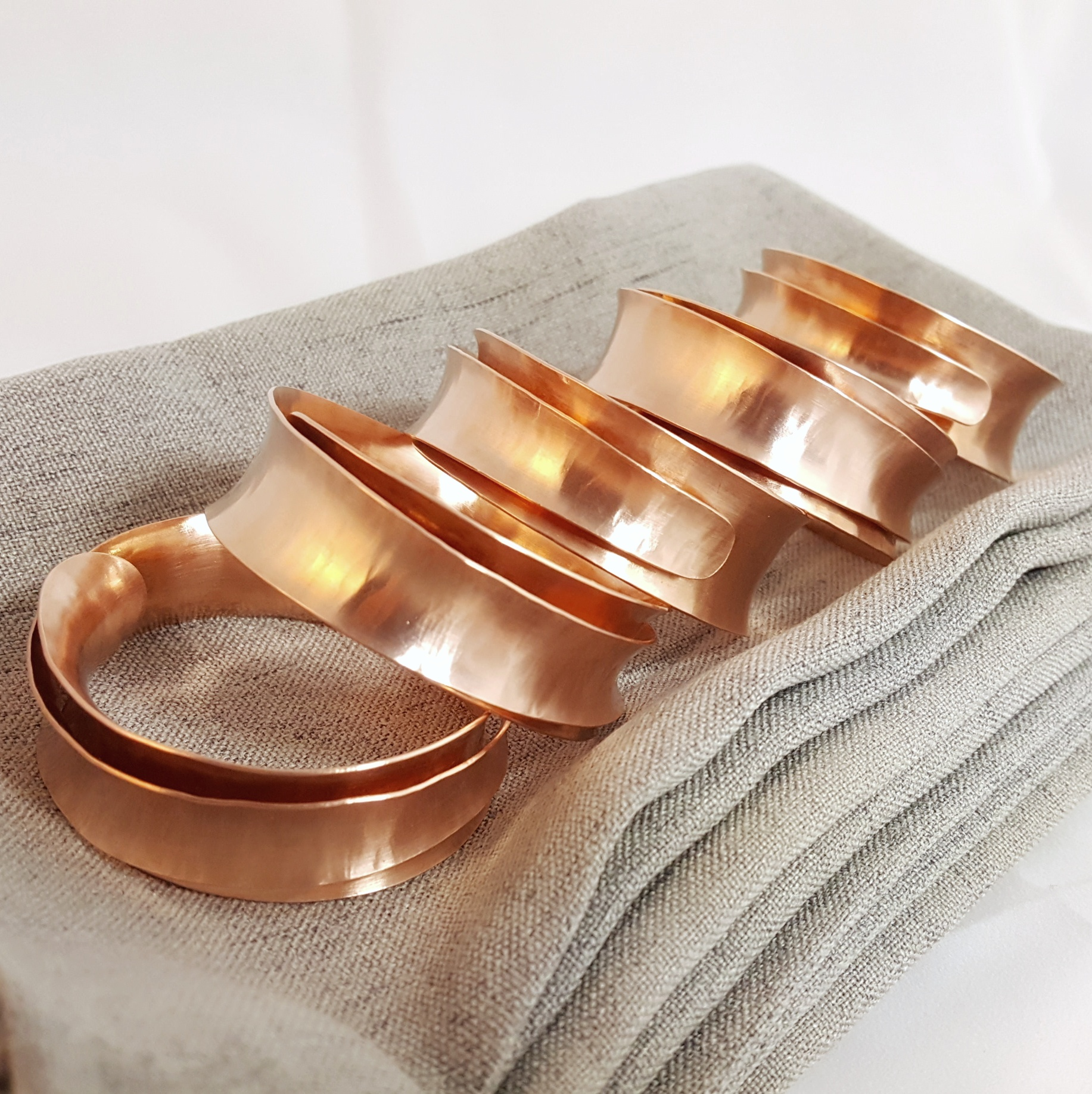 Copper napkin rings, stacked on eachother
