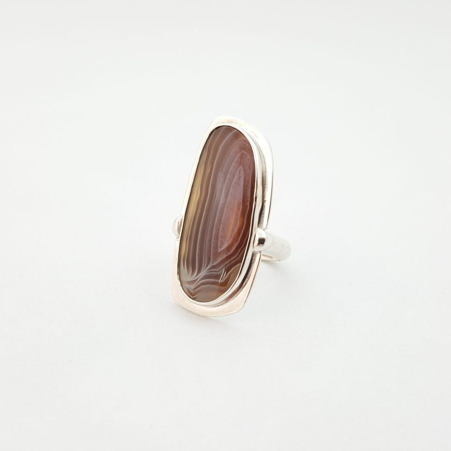 The face of a botswana agate ring set in silver