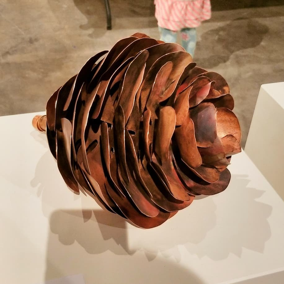 A spruce cone formed from copper sheet